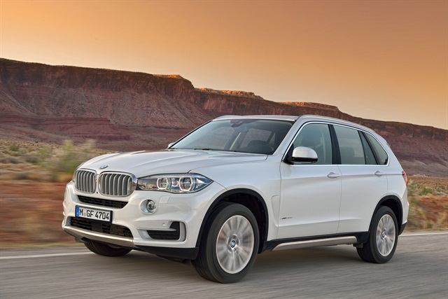 The 2014 X5 features updated, more fuel-efficient engines and new models. Photo courtesy BMW.