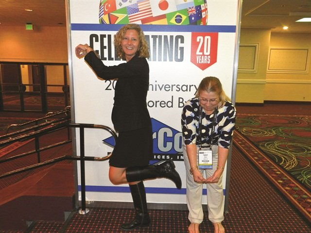 "Two attendees spell out ""20"" in honor of the International Car Rental Show's 20th anniversary. Photo by Amy Winter."