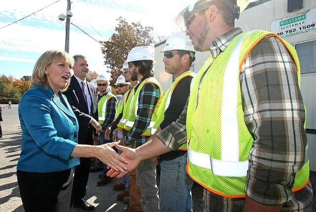 New Jersey Lieutenant Governor Kim Guadagno and Jim Fakult, Jersey Central Power & Light (JCP&L) president, greet students enrolled in the Power Systems Institute line worker training program.