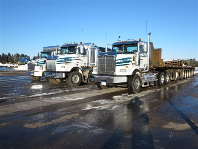 Western Star stations three vehicles at Eaton's proving grounds at Marshall, Mich., for demonstrations. From left: 4700SB 10-wheel dump, 4800SB twin-steer 8x4 dump, and 4900SB tractor.  Photo: Tom Berg