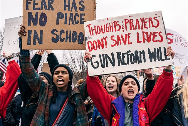 Protestors gather in support of stricter gun laws. Photo via Lorie Shaull/Wikimedia