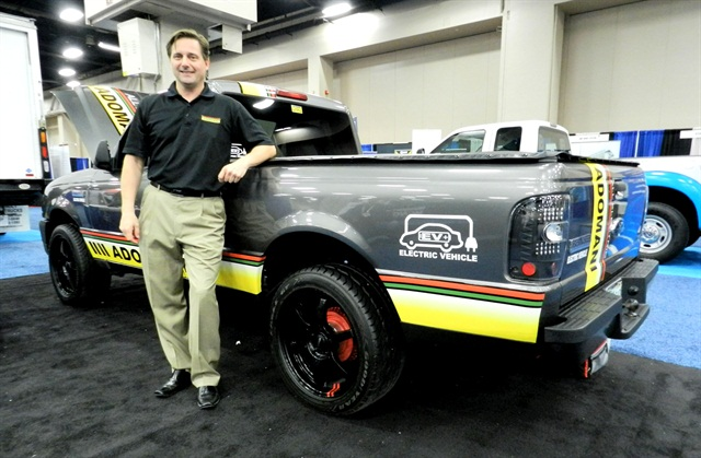 Edward Monfort stands with a display Adomani electric Ford Ranger at the 2013 GFX.