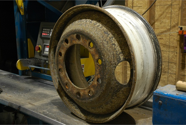 A typical wheel prior to blast-cleaning. After the blast cleaning, defects will be visible. If the DOT stamping is not clearly visible, scrap the wheel.