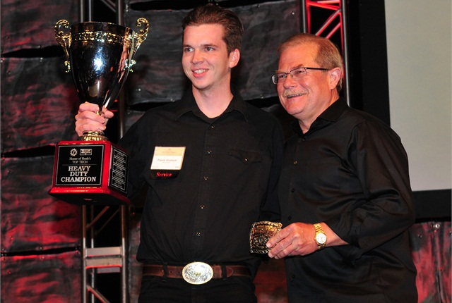 Travis Graham, left, with Rush Enterprises CEO, Rusty Rush, at the awards banquet of the 2015 Tech Skills Rodeo. Photo by Jim Park