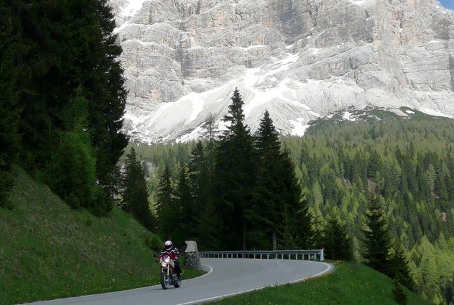 Former Remarketing Manager of Kia Motors, Dave Alfonso, rides through the Dolomites, a mountain range in northern Italy.