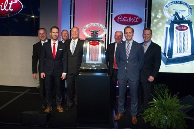 The Peterbilt Store's president and CEO John Ascott accepted the North American Dealer of the year with his two sons Jeff and Greg Arscott. Photos: Peterbilt