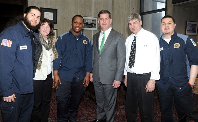 Boston's fleet internship program has been a success, resulting in two technician hires so far and praise from the mayor. Pictured l-r are: Emmanuel Estremera, former intern and now full-time fleet employee; Susan Lambert, cooperative educational coordinator from Madison Park Vocational High School; Junior Cherenfant, current intern from Madison Park; Boston Mayor Martin Walsh; Tom Rafferty, automotive instructor, Madison Park; and Hector Ramirez intern from Madison Park.