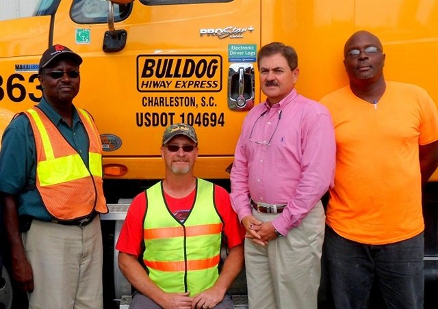 "Phil Byrd, president of Bulldog Hiway Express (second from right), seen here with several senior drivers, says the carrier wants the pay and compensation packages it offers ""to hit the bull's eye for as many drivers as possible."" Photo: Bulldog Hiway Express"
