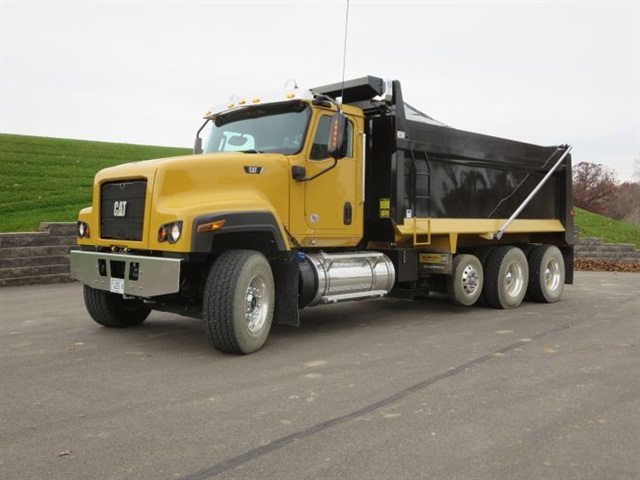 The set-forward steer axle and plain front end mark the latest Cat Truck. The headlamps are halogen sealed beams and the bumper is flat to minimize overall length.