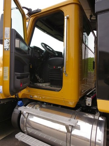 The aluminum cab sports cowl-mounted mirrors that give steady views to the rear, but limit door swing.