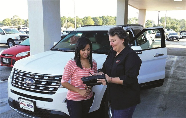 Bay Area Auto & Truck Rental in Dickinson, Texas, uses a Windows-based tablet computer with a magnetic strip and barcode reader. The computer logs into a mobile version of TSD's Rental.Net management system software and communicates via Wi-Fi. Photo courtesy of Bay Area Auto & Truck Rental.
