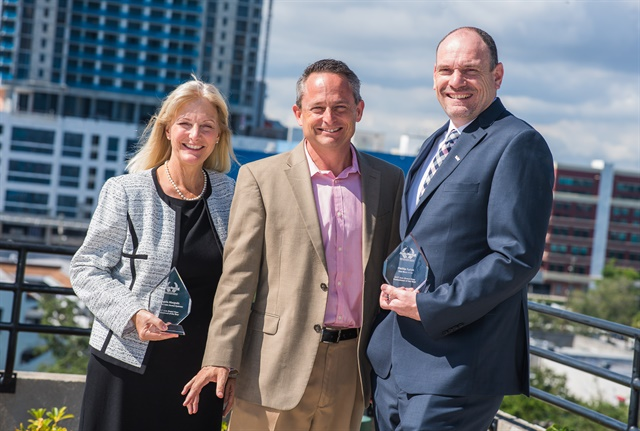 At the 2017 Auto Rental Summit, Angela Margolit (left) received the Professional of the Year Award in the vendor category and Phil Spink (right) won for the operator category. Chris Brown, executive editor of Auto Rental News (center) presented the awards. Photo by Jasen Delgado.