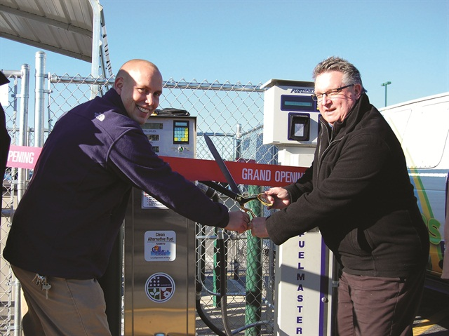Store manager Kyle Krause (left) and Menards Spokesperson Jeff Abbott cut the ribbon on a newly opening propane station at the Mernards store in Hodgkins, Ill. The hardware chain's fueling station was funded in part by a Clean Cities grant. Photo courtesy of Greg Zilberfarb, The Sales Network