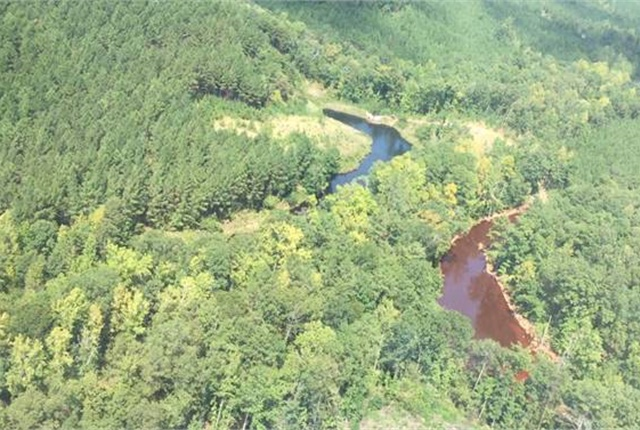 Aerial view of oil collecting in nearby retention ponds. Photo courtesy of Colonial Pipeline