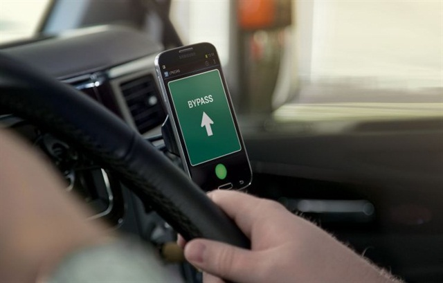 Many devices can collect data in a connected fleet, such as handhelds, tablets or smartphones, such as the device above,  receiving a weigh station bypass signal from the Drivewyze system.