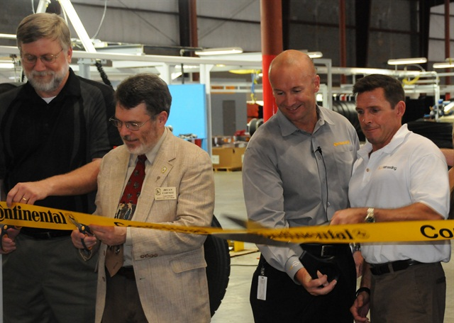 Scott Snyder, right, with Paul Williams of Continental and local dignitaries prepare to cut the ribbon officially opening DLS Retreading in Fort Mill S.C.