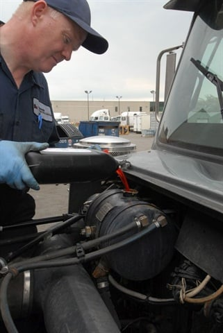 Check when adding top-off fluid that it's compatible with what's in the engine. Color isn't always a reliable guide.