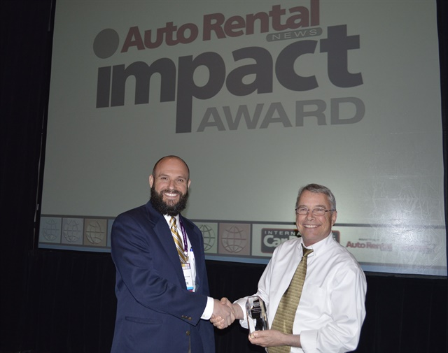 Jon Dill, contact center director at International Franchise Systems, (left) presented Michael DeLorenzo with the Auto Rental News Impact Award. Photo by Amy Winter-Hercher