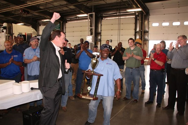 "Co-workers applaud veteran Boyd Bros. driver Willie Cooley receiving trophy from the carrier for having completed 1-million miles of safe driving. ""You have to have a system in place to keep the really good guys driving for you,"" says Boyd's Lori Furnell. ""Once they're in the door here, we have strategies in place to try to turn them into long-term employees."" Photo: Boyd Bros."
