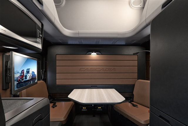 New Cascadia Elite Lounge Package with Driver's Loft and upper cargo shelf shown in Saddle Tan and Black. Photo Courtesy of Freightliner.