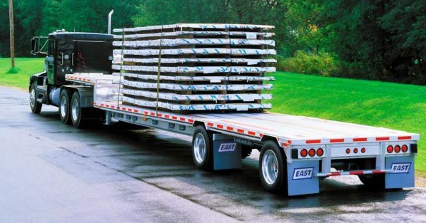 "The lower main deck of this lightweight aluminum drop-deck trailer can carry, in this case, more stacked racks than a regular flatbed. Drop or ""step decks"" can also be made of steel or a steel-aluminum combination. Photo: East Mfg."