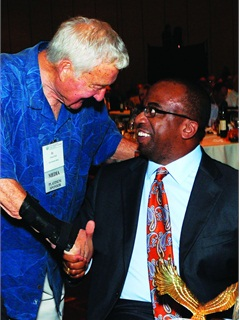 (Left) Ed Bobit, founder and chairman of Bobit Business Media, congratulates Webber on his prestigious win.