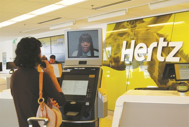 The rental counter is replaced by a concierge and kiosk system in which customers can access a live operator via the video screen.
