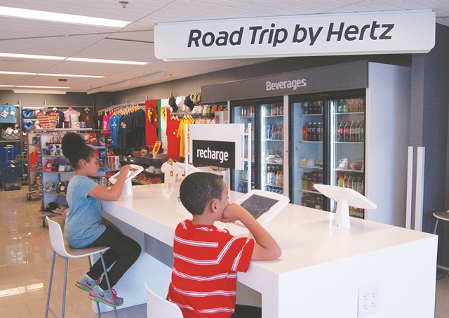 If there is a wait, customers are given pagers and are free to access an iPad station, visit the on-site convenience store or browse the featured models outside.