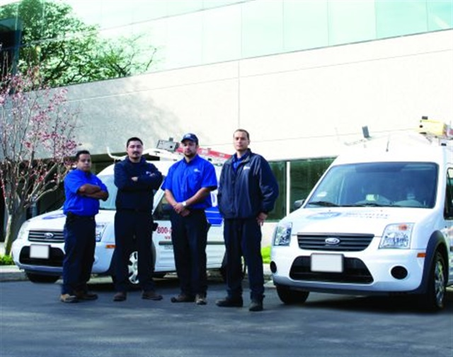 For ADT employees (l-r) Daniel Garcia, installation technician; Robert Robles, service technician; Davon Brazil, installation technician; and Jeffery Mojica, service technician, the Ford Transit Connect has helped them do their jobs better by being easier to handle and providing better access to equipment and supplies.