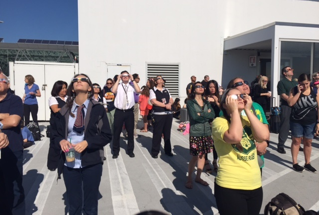 Spectators watch the solar eclipse at the top of the parking structure at Oregon's Portland International Airport. Photo courtesy of Therese Chapdelaine-Irons.