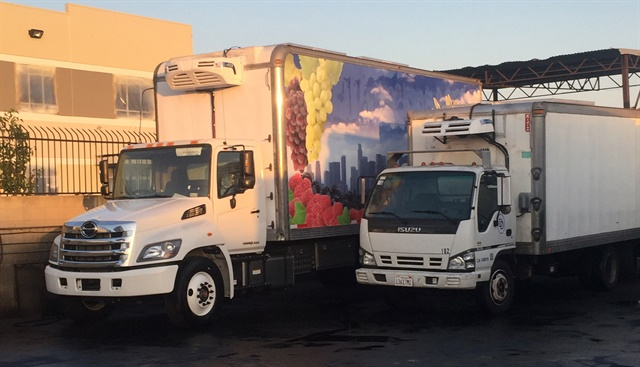 Two of D&D's trucks outfitted with Volta Air electric reefers. Photo courtesy Second Generation Cooling and Volta Air.