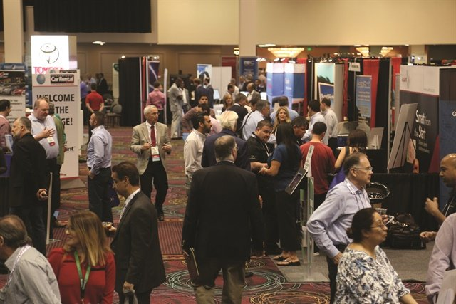 Attendees had several opportunities to interact in the expanded exhibit hall. Photo by Steve Reed.