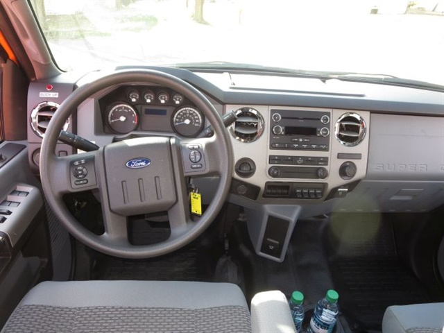 Front seats are comfortable and supportive cloth-covered buckets; the driver's is air-ride via electric pump. Instruments and switches are also from the previous generation.