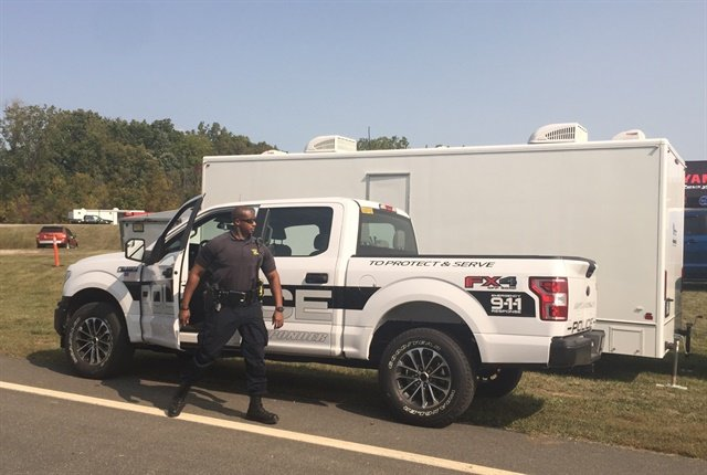 Photo of Michigan trooper dropping off Ford's F-150 Responder for ergonomics testing by Paul Clinton.