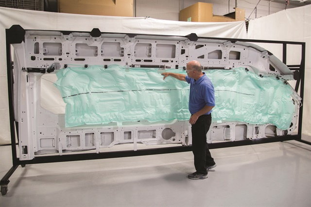 Ford introduced the automotive industry's first five-row side-curtain airbag on the 2015 Ford Transit 15-passenger wagon. The airbag measures close to 15 feet long and 3 feet tall with a volume of 120 liters. In a crash situation, a series of sensors detects the impact and triggers two of the industry's largest inflators to fill the entire airbag with stored gas in a fraction of a second. Photo courtesy of Ford.