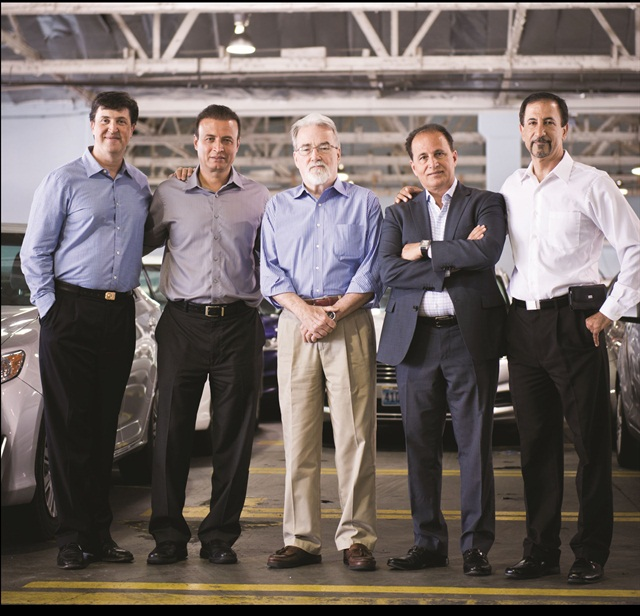 (left to right) Richard Wolff (CFO), co-owner Mike Jaberi, Joe Knight, vice president of business development, co-owner Allen Rezapour and co-owner Mark Mirtorabi assemble inside the Fox Rent A Car location serving Los Angeles Airport. Photo by Vincent Taroc.