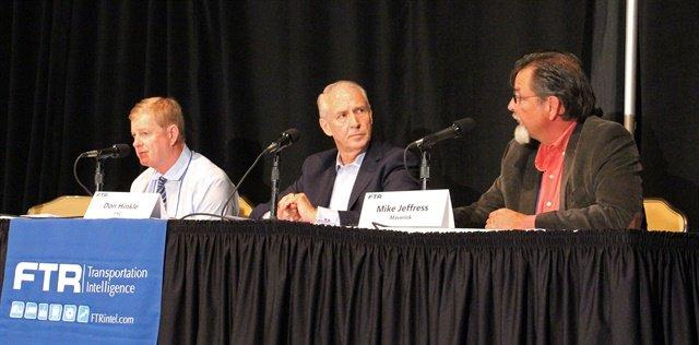 From left, Greg Eddy, president and CEO of Venture Logistics;Don Hinkle, vice president of equipment services at YRC Worldwide; and Maverick Vice President of Maintenance Mike Jeffress. Photo by Evan Lockridge