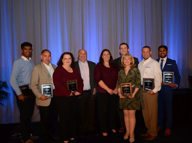 Merchants Fleet Management's Dan Hannan and Tracy DuRocher (center) pose with some of the 2016 Fleet Visionary Awards winners, including (l-r) Nikith Rajendran, Dave Mansfield, Amy McAdams, Jane Manca (on behalf of Nick Richardson), Jeff Moody (behind Manca), and Sharjeel Wattoo. Photo: Jim Park
