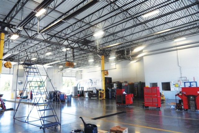Monarch Beverage in Indianapolis retrofitted its large shop with gas-safe light fixtures, methane detectors and ventilation fans as part of a conversion to CNG-powered tractors.Photo: Tom Berg
