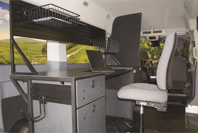 Ergonomic Solutions provided this Ford Transit van's mobile office equipment. The desk includes space for a laptop and printer, as well as drawers and baskets for storing files and papers. Photo courtesy of Ergonomic Solutions.