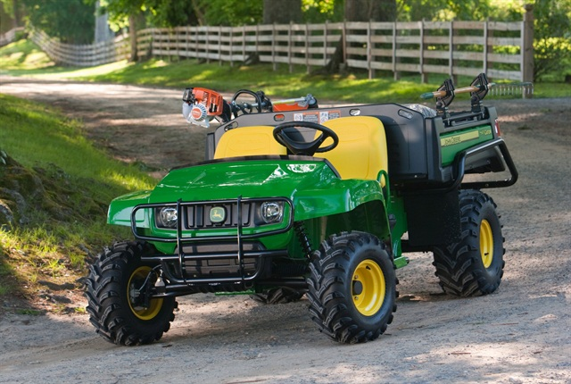 Attachments such as tool racks pictured on this John Deere Gator TX can increase the versatility of the vehicle. Photo courtesy of John Deere.