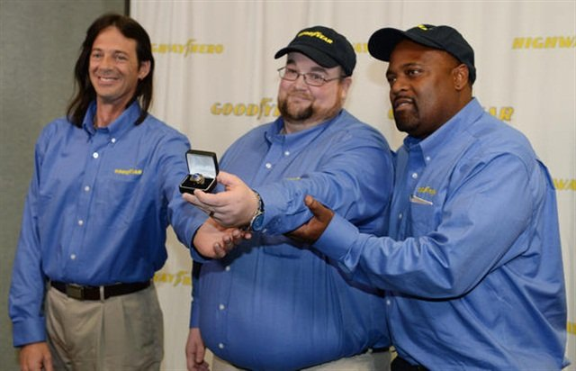 From L-R – Finalists for the 33rd Goodyear Highway Hero Award: Mike Cavanagh, winner Julian Kaczor, and Dorian Cole pose with Kaczor's commemorative Goodyear Highway Hero ring. Photo: Goodyear