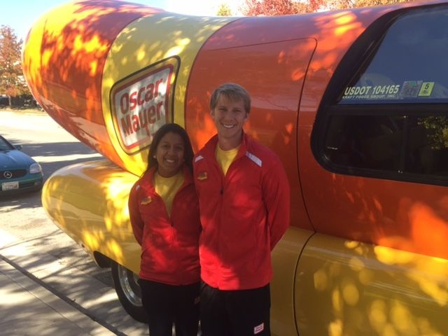 Hot Doggers (Jennifer Chow and Donald Knoelke) in front of the Oscar Mayer Wienermobile. Photo by Amy Winter-Hercher.