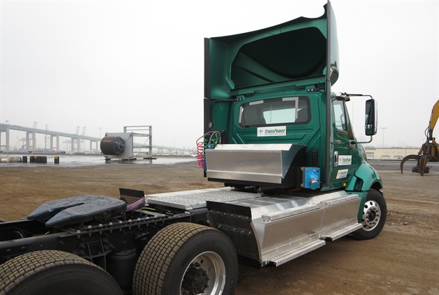Third generation of TransPower's ElecTruck powertrain includes four large battery boxes hung from frame rails and another mounted behind the cab. They contain lithium ion phosphate batteries whose total weight is about 4,500 pounds.