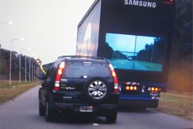 Now it's safe to go. But, would a rear-door TV showing the road ahead be practical? Photos via Samsung and YouTube