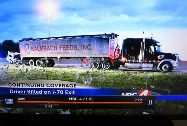 The van smacked the parked rig's rear and pushed the trailer's tandem forward. Photo: Tom Berg, image via WCMH-TV
