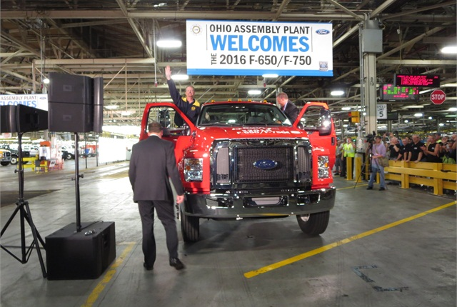 Symbolic first F-650/750 comes off the line at Ford's Ohio Assembly Plant. Joe Hinrichs, Ford president of the Americas, drove and Tim Rowe, UAW chairman at the plant, rode. Photo: Tom Berg