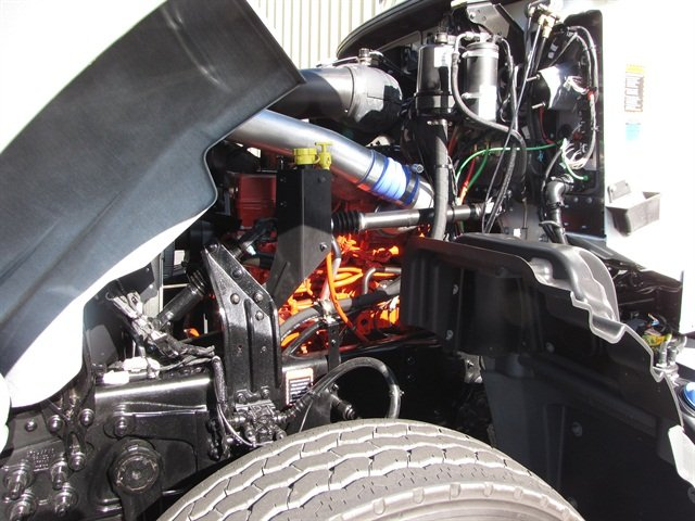 The Cummins ISL9 is masked by plumbing, but daily fluid checks are within easy reach. The 8.9-liter diesel cuts cost but still ably propels the truck with output of 345 horsepower and 1,150 pounds-feet.