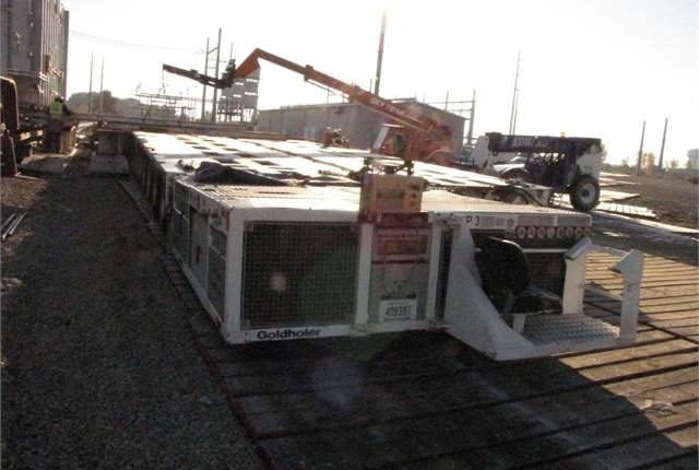 Transporter's power module is licensed in Kentucky as a truck-trailer. On previous moves the multi-wheel platform had two power modules, but a Hayes prime mover would assist on this haul.