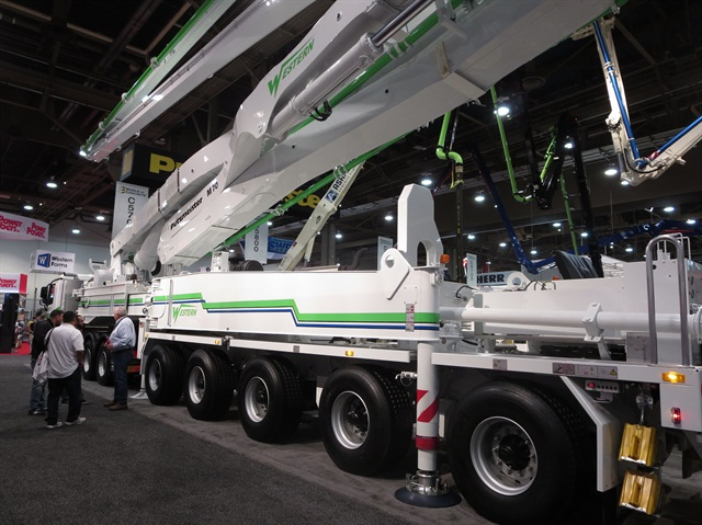 Set up in one of the World of Concrete's halls, the Putzmeister pump trailer looks longer than it is. Up front is a Mercedes-Benz cab-over-engine tractor, which came from Germany with the trailer. Photos: Tom Berg